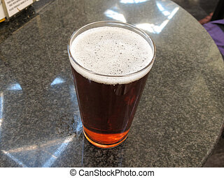 British cask ale beer - a glass of British cask ale