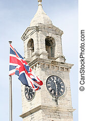 British Clock Tower - A stone and concrete clock tower with ...