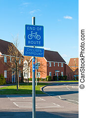 British End of Cycle Route sign in modern housing development