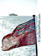 British ensign with sea, sun and a ship