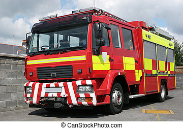 British Fire Engine - Red British fire engine standing idle...