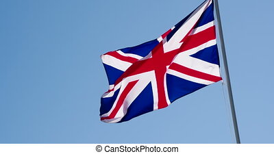 British Flag and Blue Sky - The Big State Flag is...