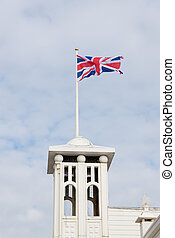 british flag waving on top of the brighton pier