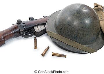 british helmet and rifle of World War II - a british helmet...