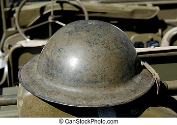 british helmet of World War II on the jeep - a british...