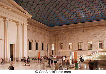British museum in London - People walking around hall of...