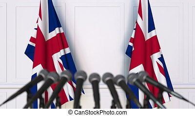 British official press conference. Flags of the United...