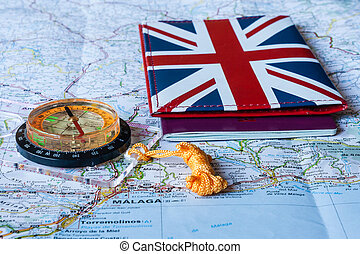 British passport with compass lying on map of Spain