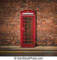 British Phone Box Against Red Brick Wall - Grungy...