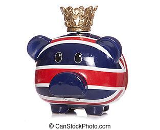 british piggy bank wearing a crown