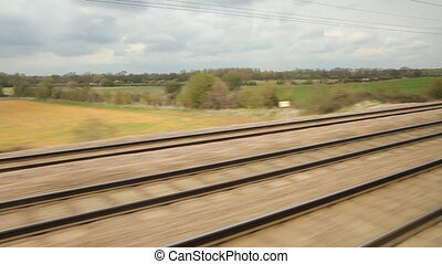 Travelling on the East Coast main line through the Bedfordshire countryside in the UK. Two shots.