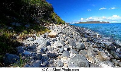 British Virgin Islands Caribbean - Waves crash ashore on the...