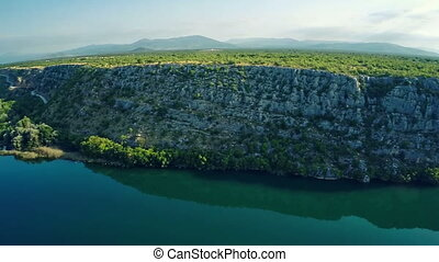 Brljan lake steep cliff - Copter aerial view of the Brljan...