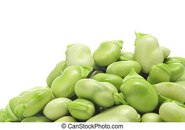 broad beans - closeup of a pile of raw broad beans on a...