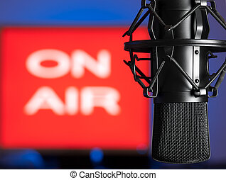 Microphone with on air sign in the background, for broadcasting, sound related themes