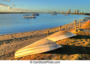 Old battered aluminium boats overlooking the Broadwater on the Gold Coast Australia at sunrise.