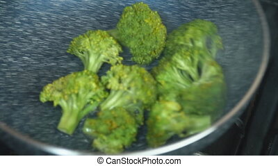 broccoli fried in a pan close-up