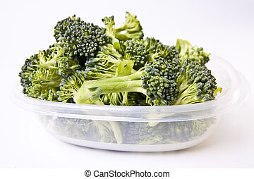 Chopped broccoli in a plastic food storage container.
