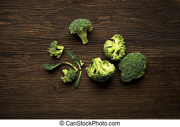 Broccoli - Fresh raw broccoli on a wooden background...