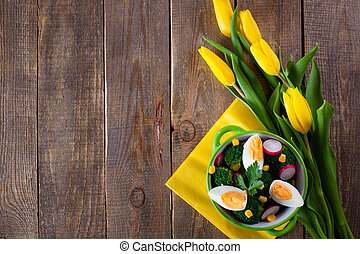 Broccoli salad with tulip flowers and copy space.
