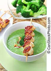 Broccoli soup roasted almond and skewered chicken