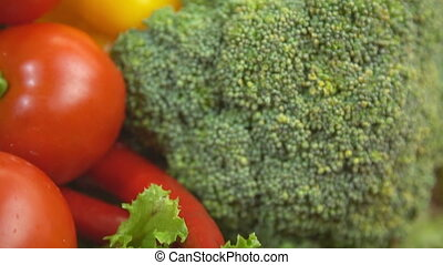 broccoli, tomato, pepper and salad close-up on a wooden...