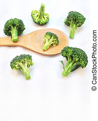 broccoli with wooden spoon