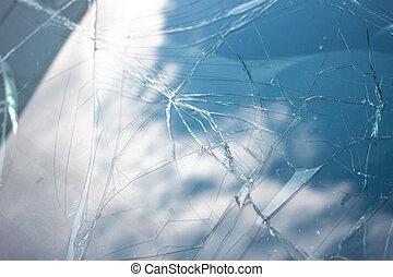 brocken car windshield with cloudy sky reflection. Damage ...