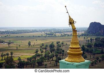 Brocken stupa on the rock near Kawgoon cave in Myanmar