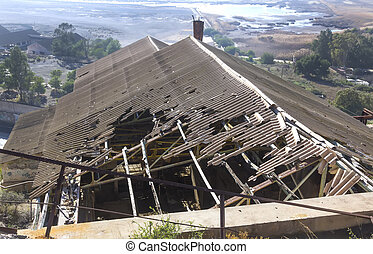 broken and destroyed roof of an old abandoned industry