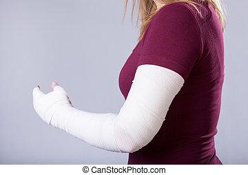 Broken arm - Closeup of young girl with broken arm