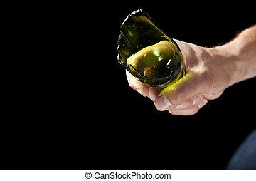 Broken beer bottle in hand