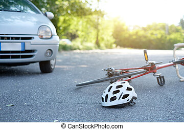 Broken bicycle on the asphalt after car crash incident