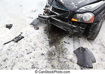 broken black car on road in winter; crash accident; crumpled hood