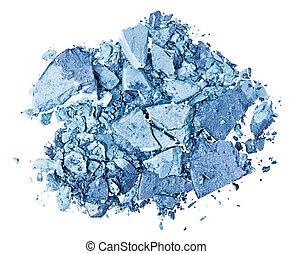 Broken blue eye shadow, isolated on white macro