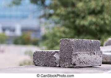 Broken brick on the wall - blurred background