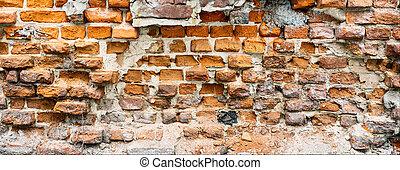 Broken brick wall. Grunge background