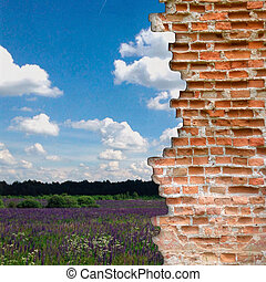 Broken brick wall with landscape behind