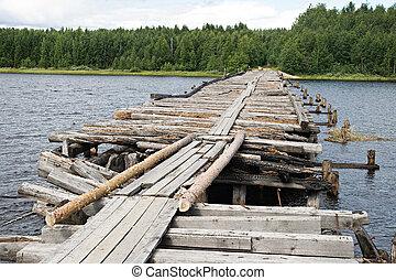 Broken bridge - An old broken bridge on a river in Karelia, ...