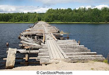 Broken bridge - An old broken bridge on a river in Karelia,...
