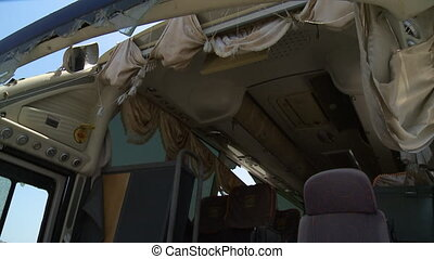 Broken bus and wind blowing through the curtains - A hand...