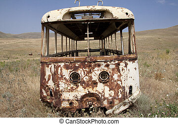 Broken bus on the meadow - Armenia. Summer day.