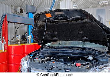 Broken car at the auto repair shop - A car in a professional...