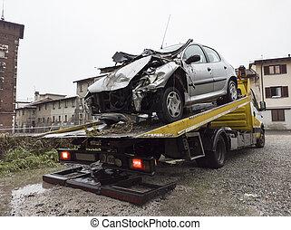 Broken car on a tow truck