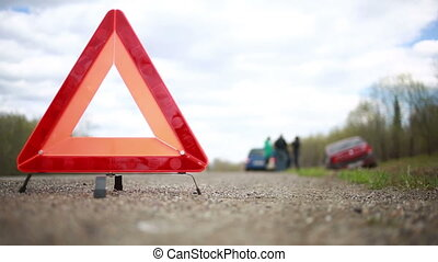 broken car on the roadside. red warning triangle. car flew ...