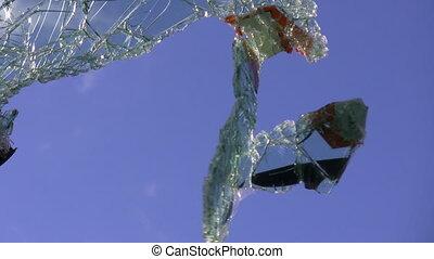 Broken car windscreen - Broken car windshield part swaying...