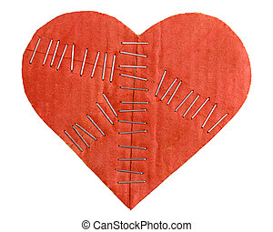 Broken cardboard heart with staples isolated on white...