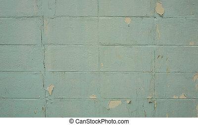 Broken cement block wall.