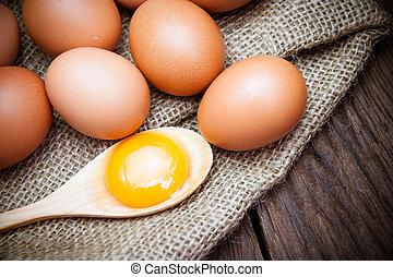broken chicken eggs and egg yolk - broken chicken eggs and...