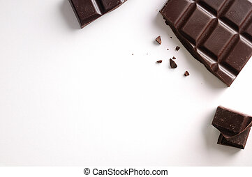 Broken chocolate bar isolated top view